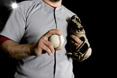A baseball player holding a baseball, midsection view Stock Photos