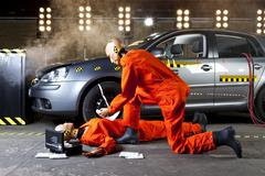 Stock Photo of A crash test dummy administering first aid on another