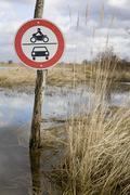 A road sign forbidding motor vehicles Stock Photos