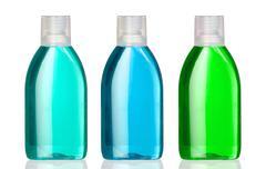 three bottles of mouthwash - stock photo