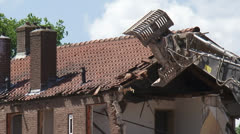 Urban renewal,  demolish a tiled roof with shovel gripper Stock Footage