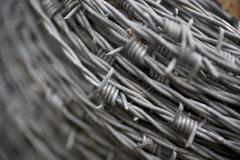 Detail of a coil of barbed wire Stock Photos