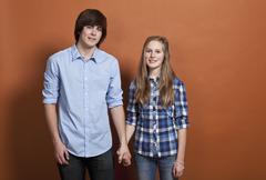 Stock Photo of A teenheterosexual couple, portrait, studio shot