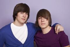 Stock Photo of Two teenboys, portrait, studio shot