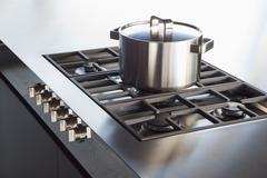 Shiny clean saucepan on hob. Stock Photos