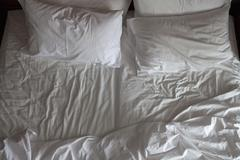 Detail of an unmade double bed Stock Photos