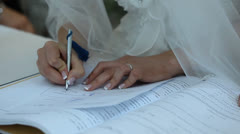 the bride signing the marriage contract - stock footage