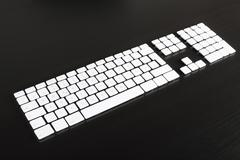 Separate computer keys arranged to look like an actual keyboard - stock photo