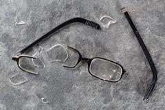 A broken pair of glasses Stock Photos