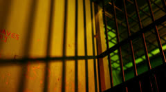 Inside Prison Cell With Shadows From Bars On The Wall HD Video Stock Footage