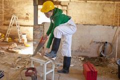 A carpenter working on a construction site Stock Photos
