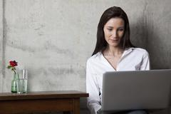 Stock Photo of A businesswoman looking at a laptop screen