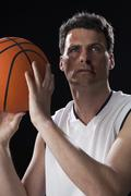 A bruised basketball player preparing to shoot a basket Stock Photos