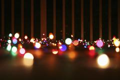 Strings of illuminated Christmas lights laying on a balcony, outdoors Stock Photos