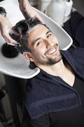 A man having his hair washed at a hair salon - stock photo