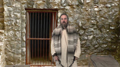 Paul dictats an Epistle in Chains Stock Footage