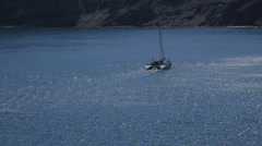 Catamaran sails on the Blue bay Stock Footage