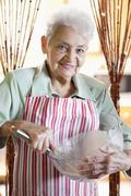 Portrait of a senior woman mixing ingredients in a bowl Stock Photos