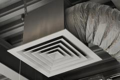 An air duct hanging from a ceiling, close-up, low angle view Stock Photos