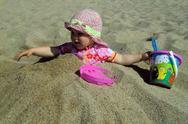 Portrait of little cute blond girl  on the beach Stock Photos