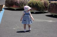 Little cute blond girl  at the port in porto cervo. sardinia Stock Photos