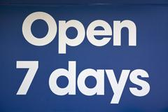 Open 7 days sign, close-up, full frame Stock Photos