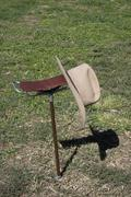 A hat on a folding chair Stock Photos