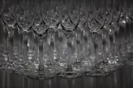 Stock Photo of Abundance of champagne flutes in a row