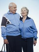 Senior couple wearing tracksuits ready for sport - stock photo