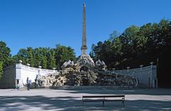 Austria, Vienna, Obelisk fountain at Schonbrunn palace with empty bench in the Stock Photos