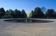 Austria, Vienna, water fountain with Schonbrunn Palace seen far in the Stock Photos