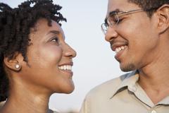 Portrait of a couple face to face Stock Photos