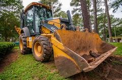 front of backhoe - stock photo