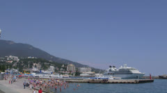 Embankment of the resort town Yalta with moored Seabourn Odyssey Stock Footage