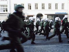Riot police running in street Kuvituskuvat