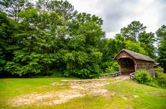 old wooden covered bridge in alabama - stock photo