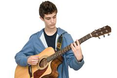 Teenager playing acoustic guitar on white background Stock Photos