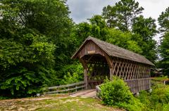 Old wooden covered bridge in alabama Stock Photos