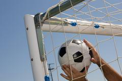 Soccer ball in the goal net Stock Photos