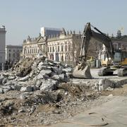 An earth mover and rubble with view of German historical museum (Zeughaus) in Stock Photos