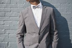 A man wearing a bow tie and suit, midsection Stock Photos