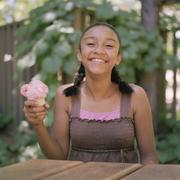 A teengirl holding an ice cream cone - stock photo