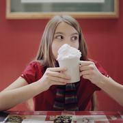A teengirl holding a mug of hot chocolate Stock Photos