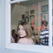 A teengirl looking through a cafe window Stock Photos