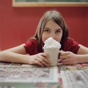 A teengirl with a mug of hot chocolate Stock Photos