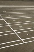 Numbered lanes on a track field Stock Photos