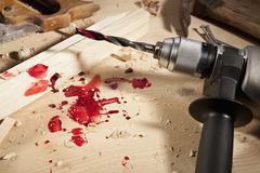 A power drill with blood on it Stock Photos