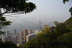 Honk Kong island and Kowloon seen from Victoria Peak - stock photo