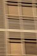 Louvered wooden slats in front of window Stock Photos
