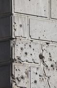 Bullet holes over facade of old building Stock Photos